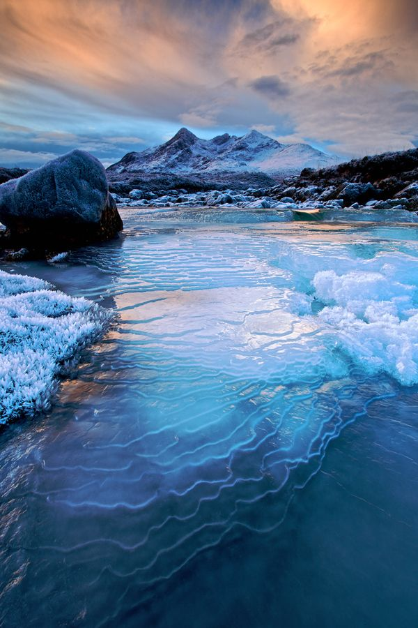 Snow covered Cuillin Hills and frozen river at Sligachan, Isle of Skye