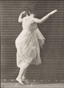 Woman_in_long_dress_dancing_(rbm-QP301M8-1887-187a-5)