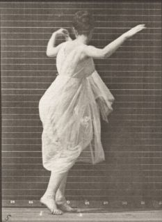 Woman_in_long_dress_dancing_(rbm-QP301M8-1887-187a-5)